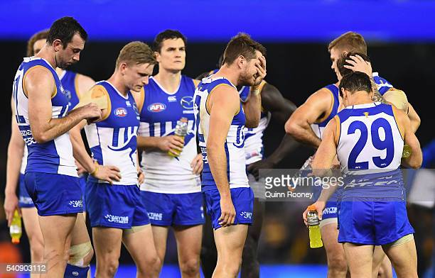 The Kangaroos look dejected after losing the round 13 AFL match between the North Melbourne Kangaroos and the Hawthorn Hawks at Etihad Stadium on...