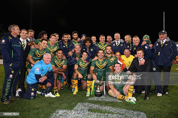 The Kangaroos pose with the trophy after winning the ANZAC Test match between the Australian Kangaroos and the New Zealand Kiwis at Canberra Stadium...