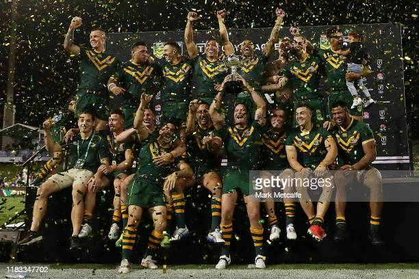 The Kangaroos pose with the trophy after winning the International Rugby League Test Match between the Australian Kangaroos and the New Zealand Kiwis...