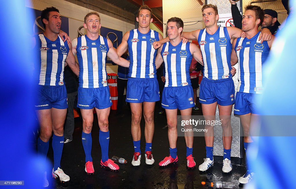 The Kangaroos sing the saong in the rooms after winning the round four AFL match between the Geelong Cats and the North Melbourne Kangaroos at Simonds Stadium on April 26, 2015 in Geelong, Australia.