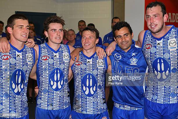 The Kangaroos sing their team song after winning the round 11 AFL match between the West Coast Eagles and the North Melbourne Kangaroos at Patersons...