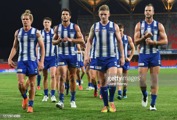 The Kangaroos walk off after they were defeated by the Eagles during the round 18 AFL match between the North Melbourne Kangaroos and the West Coast...