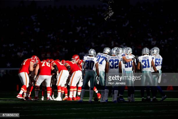 The Kansas City Chiefs and Dallas Cowboys huddle during a football game at ATT Stadium on November 5 2017 in Arlington Texas