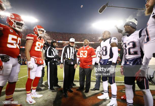 The Kansas City Chiefs and New England Patriots meet at the 50 yard line for the coin toss during the AFC Championship Game at Arrowhead Stadium on...