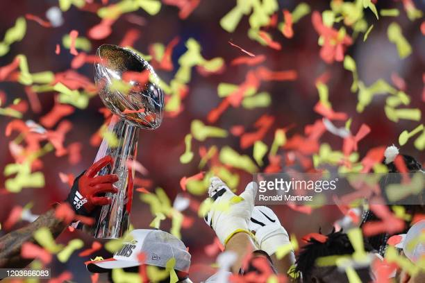 The Kansas City Chiefs celebrate with the Vince Lombardi Trophy after defeating the San Francisco 49ers 31-20 in Super Bowl LIV at Hard Rock Stadium...