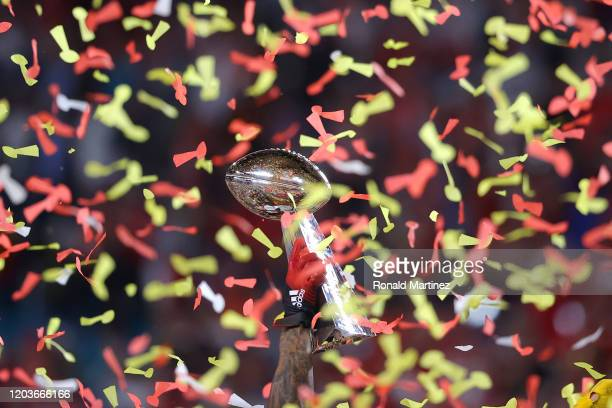 The Kansas City Chiefs celebrate with the Vince Lombardi Trophy after defeating the San Francisco 49ers 3120 in Super Bowl LIV at Hard Rock Stadium...