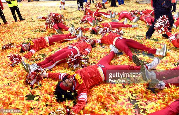 The Kansas City Chiefs cheerleaders celebrate on the field after defeating the Tennessee Titans in the AFC Championship Game at Arrowhead Stadium on...