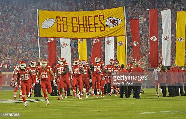 The Kansas City Chiefs enter the field prior to the game against the New England Patriots on September 29 2014 at Arrowhead Stadium in Kansas City...