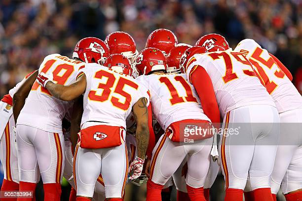 The Kansas City Chiefs huddle in the first quarter against the New England Patriots during the AFC Divisional Playoff Game at Gillette Stadium on...