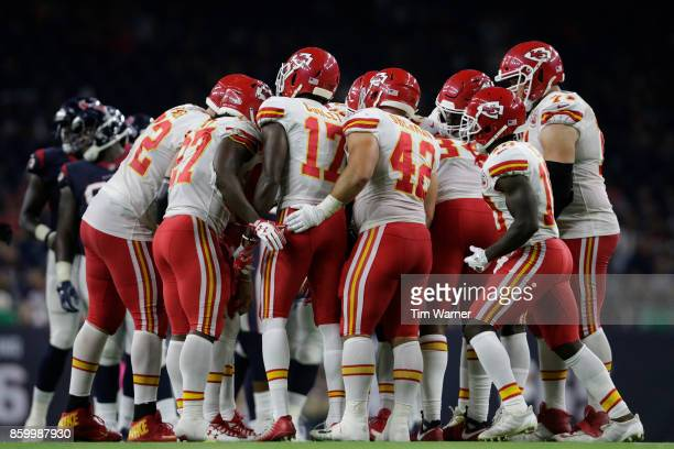 The Kansas City Chiefs huddle in the second half against the Houston Texans at NRG Stadium on October 8 2017 in Houston Texas