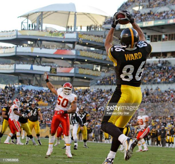 The Kansas City Chiefs' Kawika Mitchell can only watch as Pittsburgh Steelers wide receiver Hines Ward catches a touchdown pass in the second quarter...