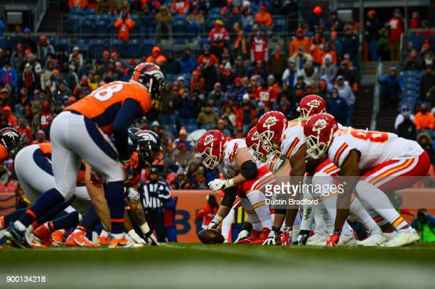 The Kansas City Chiefs line up on offense behind offensive tackle Jordan Devey in the third quarter of a game at Sports Authority Field at Mile High...