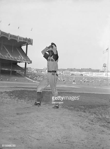 The Kansas City Monarchs baseball player Satchel Paige winds up for the pitch during a practice session.