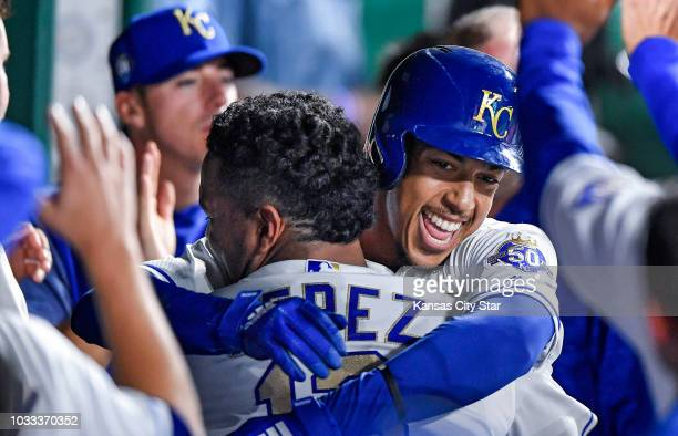The Kansas City Royals' Adalberto Mondesi gets a hug and a lift from Salvador Perez after Mondesi hit a solo home run in the seventh inning against...