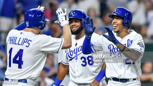 The Kansas City Royals' Adalberto Mondesi is congratulated by Jorge Bonifacio and Brett Phillips after Mondesi hit a threerun home run in the seventh...