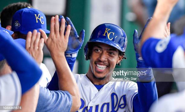 The Kansas City Royals' Adalberto Mondesi is greeted in the dugout after scoring on a single by Salvador Perez in the first inning against the...