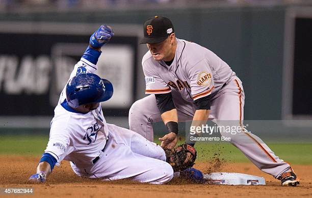 The Kansas City Royals' Alcides Escobar attempts to steal second and is tagged out by San Francisco Giants second baseman Joe Panik right in the...