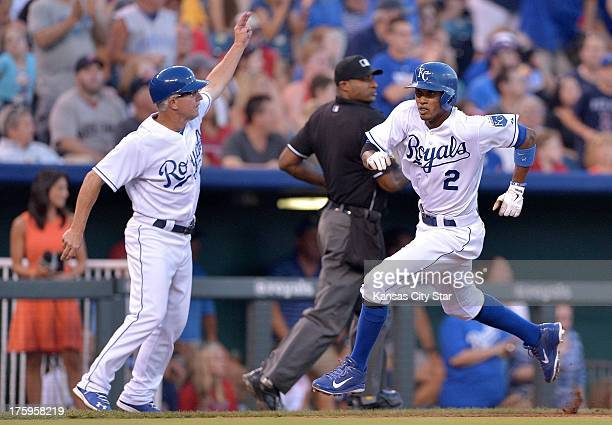 The Kansas City Royals' Alcides Escobar heads for home with the encouragement of third base coach Eddie Rodriguez on a double by Eric Hosmer in the...