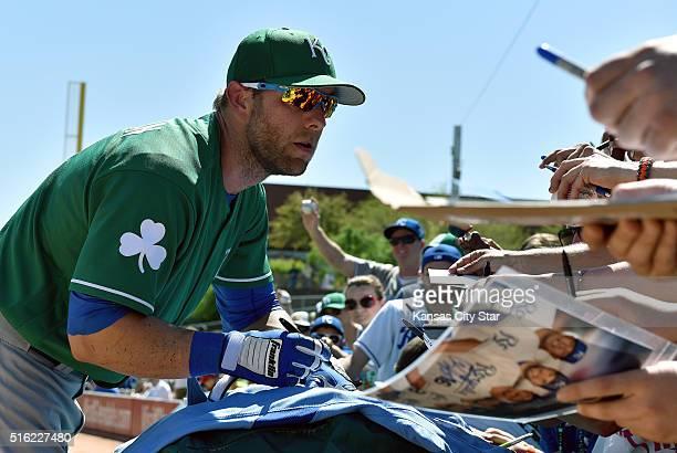 The Kansas City Royals' Alex Gordon signed autographs aspring training baseball against the Los Angeles Dodgers on Thursday March 17 at Camelback...