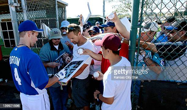 The Kansas City Royals' Alex Gordon signs autographs during the first day of full squad workouts at spring training in Surprise Arizona Saturday...