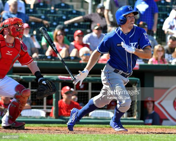 The Kansas City Royals' Billy Burns follows through on a solo home run during spring training action against the Cincinnati Reds at Goodyear Ballpark...