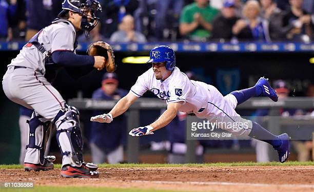 The Kansas City Royals' Billy Burns scores under the throw to Minnesota Twins catcher John Ryan Murphy in the eighth inning on a tworun single by...