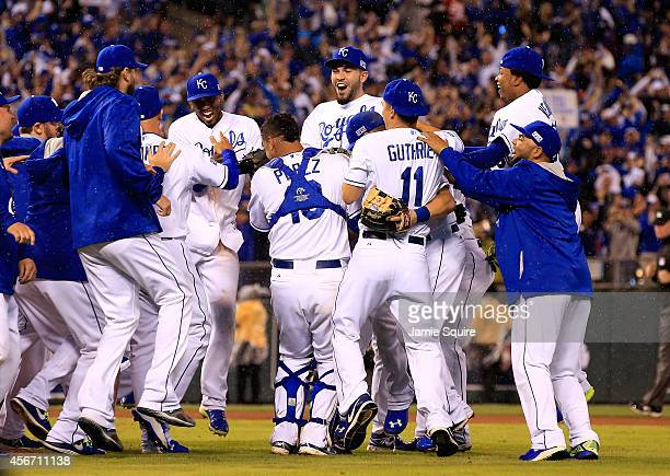 The Kansas City Royals celebrate after defeating the Los Angeles Angels 8-3 to sweep the series in Game Three of the American League Division Series...