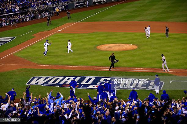 The Kansas City Royals celebrate after defeating the San Francisco Giants by a score of 100 to win Game Six of the 2014 World Series at Kauffman...