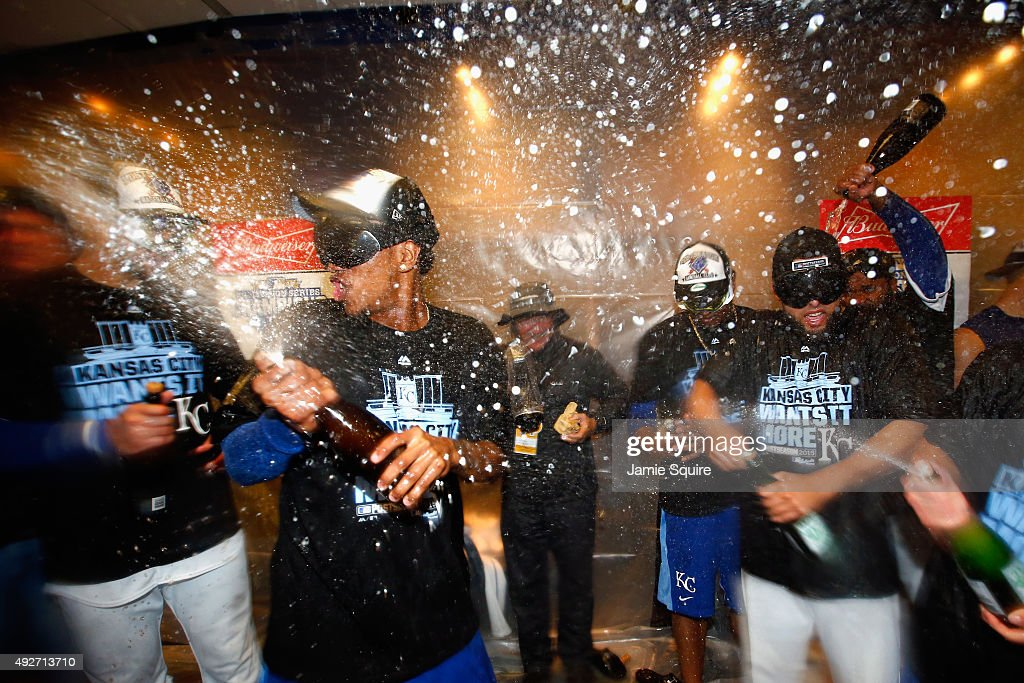 The Kansas City Royals celebrate in the clubhouse after defeating the Houston Astros 7-2 in game five of the American League Divison Series at Kauffman Stadium on October 14, 2015 in Kansas City, Missouri.