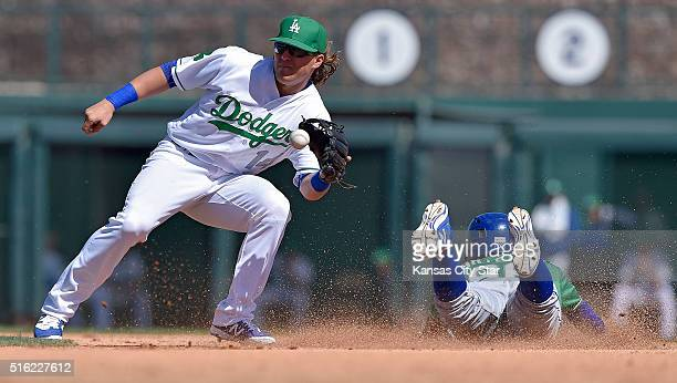 The Kansas City Royals' Humberto Arteaga steals second before the throw to Los Angeles Dodgers second baseman Kike Hernandez left in the fifth inning...