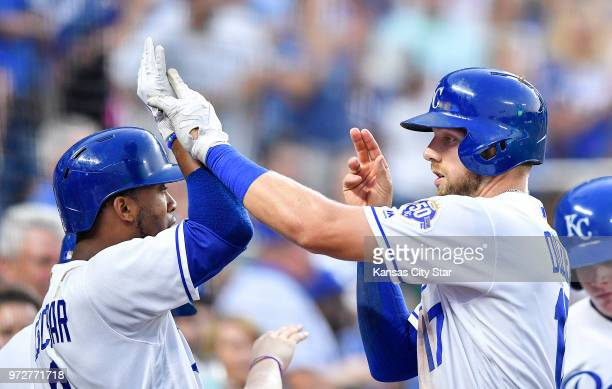 The Kansas City Royals' Hunter Dozier right is congratulated by Alcides Escobar after Dozier hit a solo home run in the fifth inning against the...