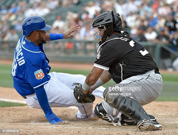 The Kansas City Royals' Jorge Bonifacio left is tagged out at the plate by Chicago White Sox catcher Hector Sanchez in the eighth inning on Saturday...