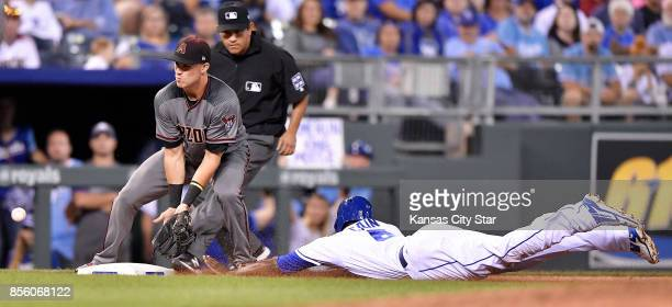 The Kansas City Royals' Lorenzo Cain steals second ahead of the throw to Arizona Diamondbacks infielder Jake Lamb in the fourth inning at Kauffman...