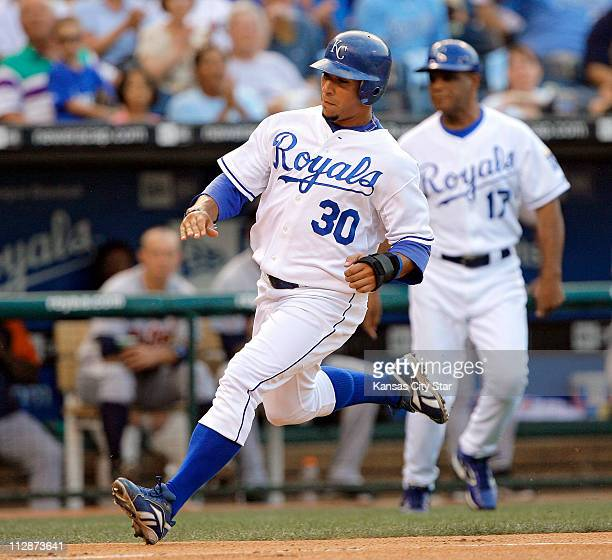 The Kansas City Royals' Mike Aviles heads for home on a double by teammate Mark Grudzielanek in the first inning against the Detroit Tigers at...