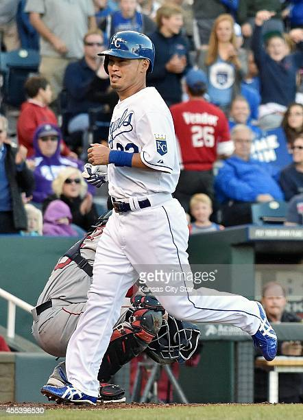 The Kansas City Royals' Norichika Aoki scores on a throwing error by Boston Red Sox catcher Christian Vazquez trying to pick off Aoki at third in the...