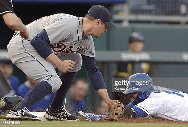 The Kansas City Royals' Omar Infante right reaches third base on a triple ahead of the throw to the Detroit Tigers' Don Kelly in the first inning on...