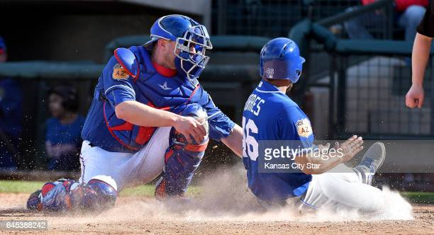 The Kansas City Royals' Ramón Torres is tagged out by Texas Rangers catcher Steven Lerud left in the ninth inning during a spring training game in...