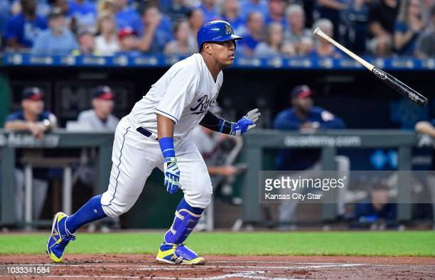 The Kansas City Royals' Salvador Perez flips his bat on an RBI single that scored Adalberto Mondesi in the first inning against the Minnesota Twins...
