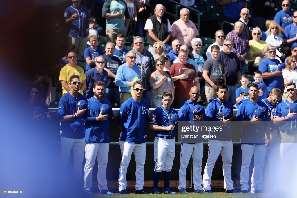 The Kansas City Royals stand attended for the national anthem before the spring training game aat Surprise Stadium on February 26, 2017 in Surprise, Arizona.