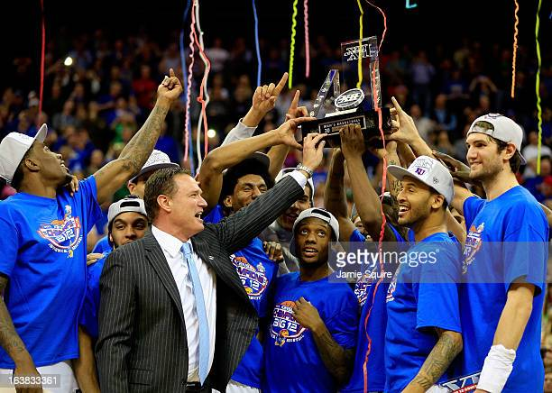 The Kansas Jayhawks and head coach Bill Self celebrate with the trophy after their 7054 win over the Kansas State Wildcats during the Final of the...