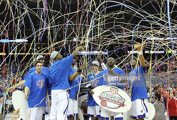The Kansas Jayhawks celebrate after defeating the Texas Longhorns 8573 to win the 2011 Phillips 66 Big 12 Men's Basketball Tournament championship...