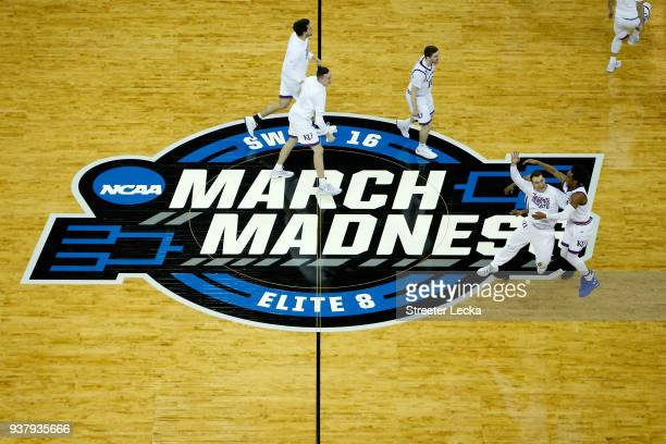 The Kansas Jayhawks celebrate defeating the Duke Blue Devils with a score of 81 to 85 in the 2018 NCAA Men's Basketball Tournament Midwest Regional...