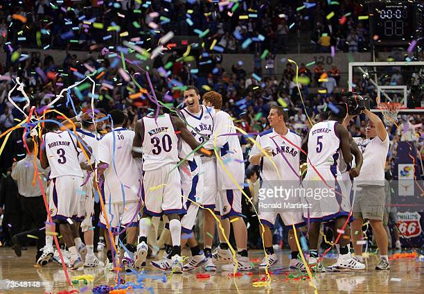 The Kansas Jayhawks celebrate following the Jayhawks victory in the finals of the Phillips 66 Big 12 Men's Basketball Championship against the Texas...