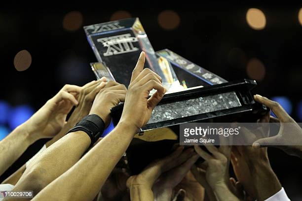 The Kansas Jayhawks celebrate with the championship trophy after defeating the Texas Longhorns 8573 to win the 2011 Phillips 66 Big 12 Men's...