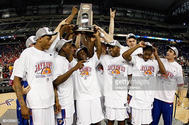 The Kansas Jayhawks celebrate with the Midwest Region trophy after their 59-57 win against the Davidson Wildcats during the Midwest Regional Final of...