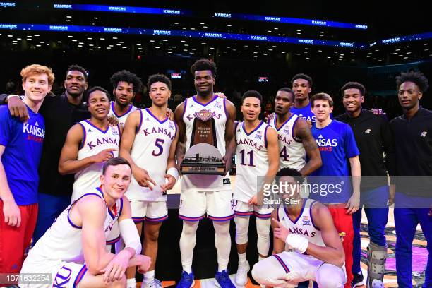 The Kansas Jayhawks celebrate with the trophy after Kansas' 8781 win over Tennessee Volunteers at the NIT Season TipOff Tournament at Barclays Center...