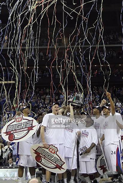 The Kansas Jayhawks display the trophy after defeating the Kansas State Wildcats to win the 2010 Phillips 66 Big 12 Men's Basketball Championship on...