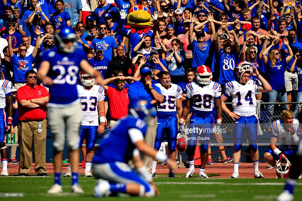 The Kansas Jayhawks mascot, Big Jay, watches in the crowd as kicker Matthew Wyman #28 of the Kansas Jayhawks prepares to kick the game-winning field goal in the final seconds as the Jayhawks defeated the Louisiana Tech Bulldogs 13-10 turnover win the game at Memorial Stadium on September 21, 2013 in Lawrence, Kansas.