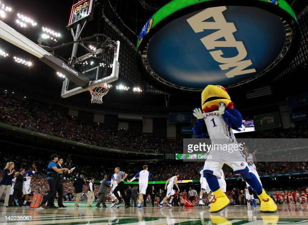 The Kansas Jayhawks mascot celebrates the Jayhawks 6462 victory against the Ohio State Buckeyes during the National Semifinal game of the 2012 NCAA...