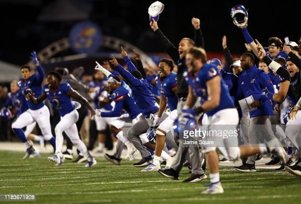 The Kansas Jayhawks storm the field and celebrate as they defeat the Texas Tech Red Raiders 37-34 to win the game at Memorial Stadium on October 26,...